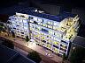 Wyższe kondygnacje budynku będą cofnięte w stosunku do niższych pięter.