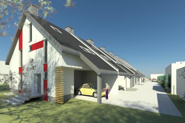 W ramach inwestycji powstał ciąg domów szeregowych z zadaszonymi miejscami postojowymi.