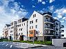 Na najwyższych kondygnacjach budynku znajdują się dwupoziomowe mieszkania.