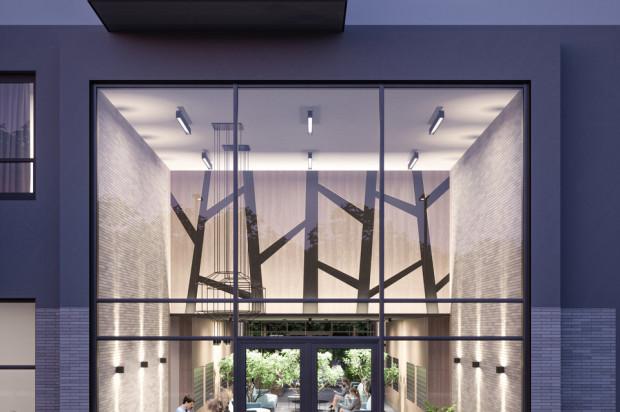 Lobby wysokiego budynku o podwyższonym standardzie.