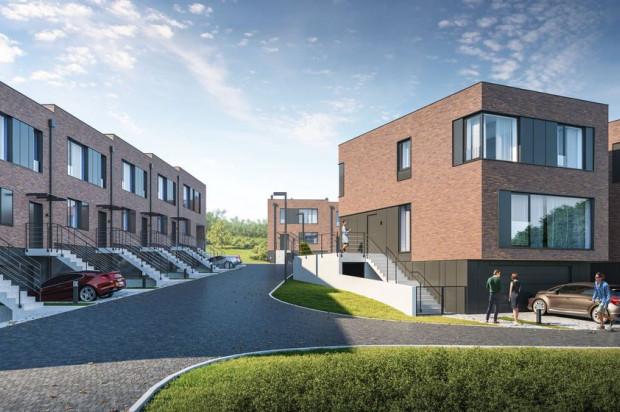 Budynki będą miały trzy kondygnacje, w tym dwustanowiskowe garaże.