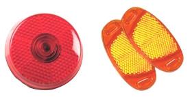 Tradycyjne, najprostsze odblaski rowerowe (tylne czerwone i boczne pomarańczowe na szprychy koła).
