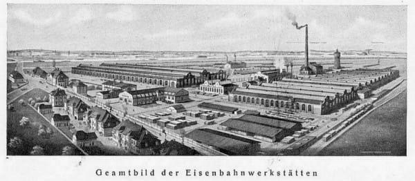 Historyczne zdjęcie Zakładów Naprawczych Taboru Kolejowego. Widok od wschodu. Po prawej stronie znajduje się wspomniana hala naprawy wagonów towarowych.