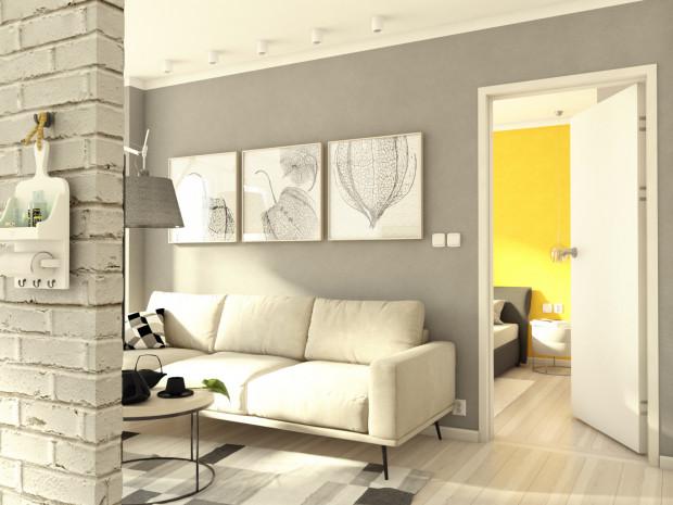 Koncepcja druga. Biała cegła, szare ściany oraz jasna kolorystyka wyposażenia sprawiają, że wnętrze jest odczytywane jako lekkie i większe.