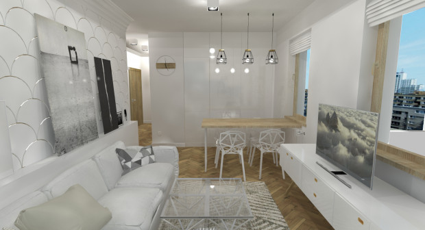 Koncepcja pierwsza. Ułożona na podłodze jodełka optycznie załamuje przestrzeń, dzięki czemu pomieszczenie wydaje się większe. Taką samą rolę pełni faktura na ścianie. Dopasowanie drewnianych detali zabudowy, stołu z drewnem na podłodze sprawia, że wnętrze jest spójne.