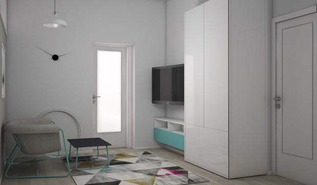 Koncepcja pierwsza. We wspólnym pokoju do zabaw znalazło się miejsce na sofę oraz telewizor. To pomieszczenie jest również dodatkową przestrzenią do przechowywania.