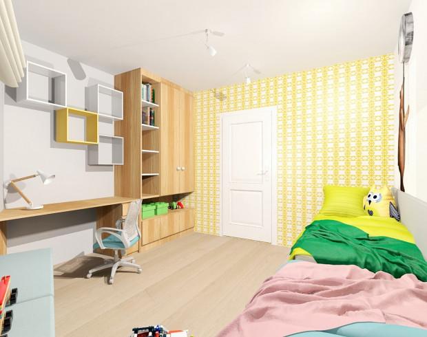 Koncepcja pierwsza. Ściana przy wejściu została obłożona żółtą tapetą, która ożywi przestrzeń. Wyraźny wzór pełen drobnych elementów wpłynie także na optyczne powiększenie wnętrza.