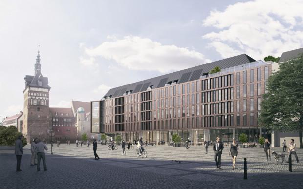 Widok zabudowy od strony Targu Węglowego. W zamierzeniu architektów architektura nowego obiektu nie miała konkurować z Bramą Wyżynną, Katownią oraz Bractwem św. Jerzego.