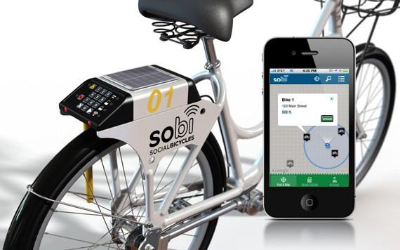 Przykładowy komputer pokładowy i aplikacja mobilna systemu roweru publicznego czwartej generacji, niezależnego od stacji dokujących.