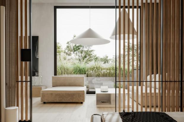Duże okna podkreślają nieodzowny w przypadku japońskich wnętrz kontakt z naturą.