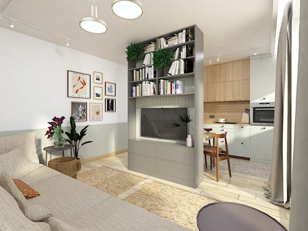 Pierwsza koncepcja zakłada oddzielenie kuchni od strefy dziennej przy pomocy pojemnej zabudowy.