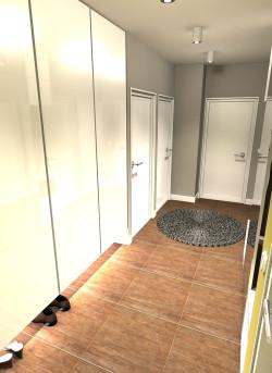 Wariant kolorystyczny łagodny. Widok od strony wejścia na szafę wnękową. Podświetlenie ledem spodu szafy ułatwia znalezienie własnego obuwia.